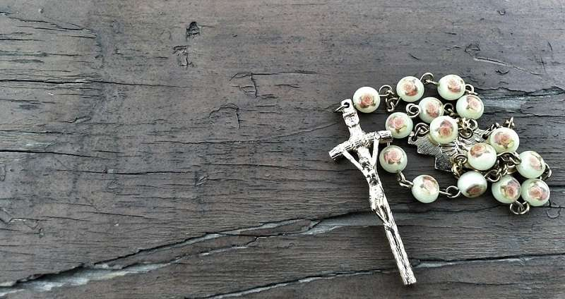 When is it superstitious or wrong to carry a Rosary?