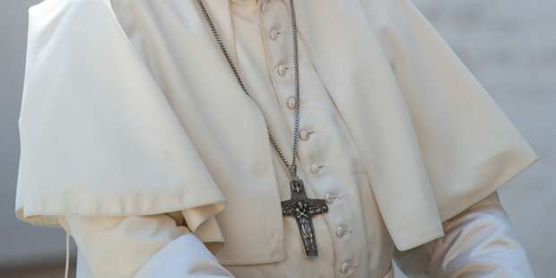 Why does Pope Francis wear a silver cross?