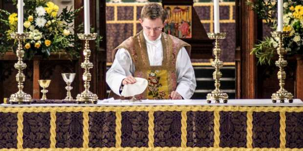 Why do priests wear different color vestments?