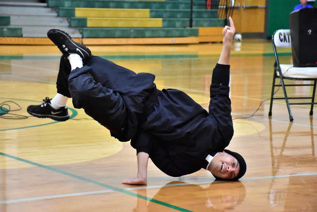 3 Priests breakdance their way into students' hearts