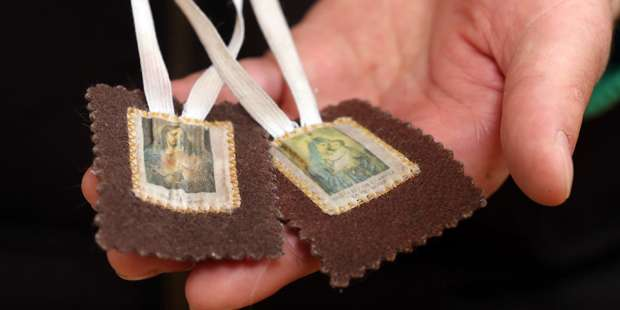 This priest was saved from a bullet by wearing his Brown Scapular