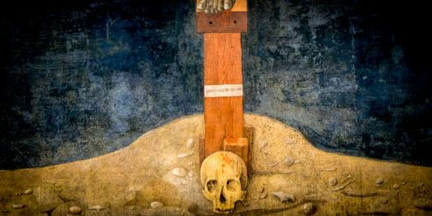 Why is there a skull beneath my crucifix?