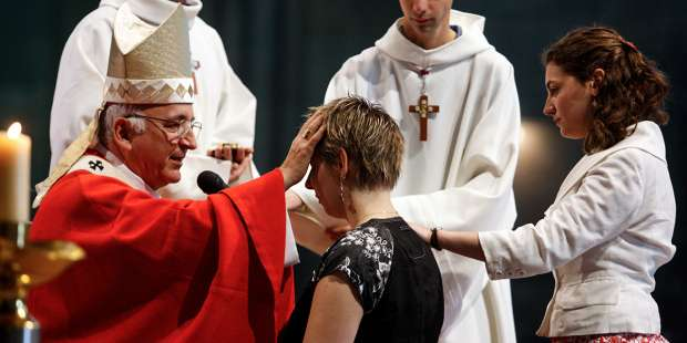 What are the sacraments of initiation in the Catholic Church?
