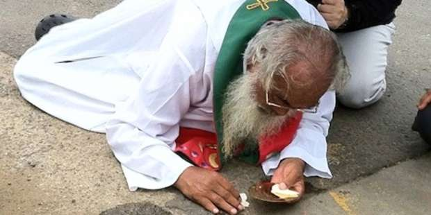 They knocked him to the ground, but all he cared about was the Eucharist
