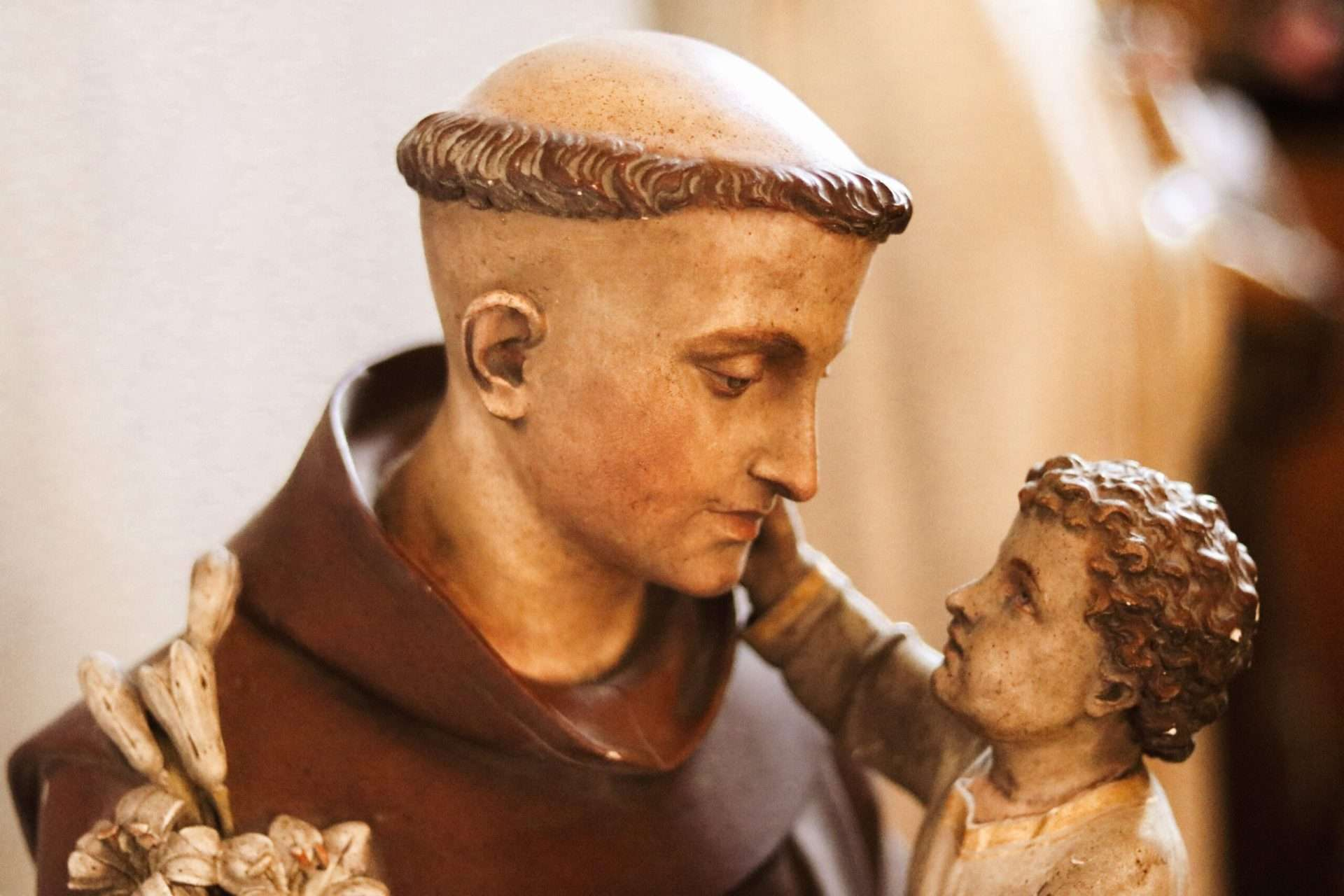 Why is Saint Anthony depicted holding the Child Jesus?